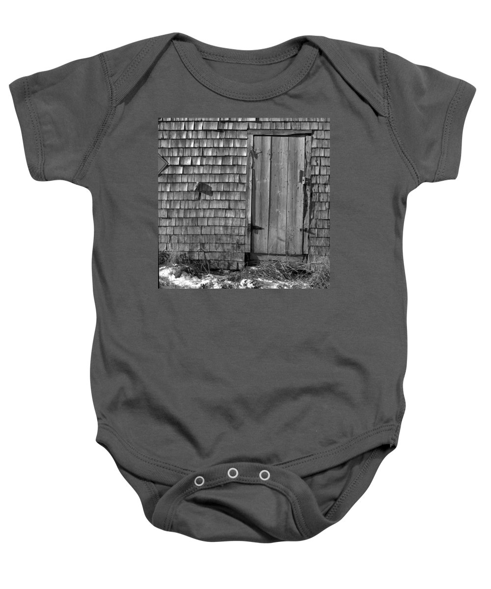 Black And White Baby Onesie featuring the photograph Fishing Shed 12 by Timothy Bischoff