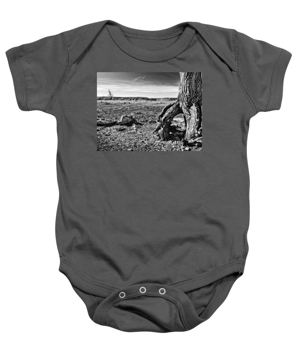 Black And White Baby Onesie featuring the photograph Flint Hills Moonscape by Eric Benjamin