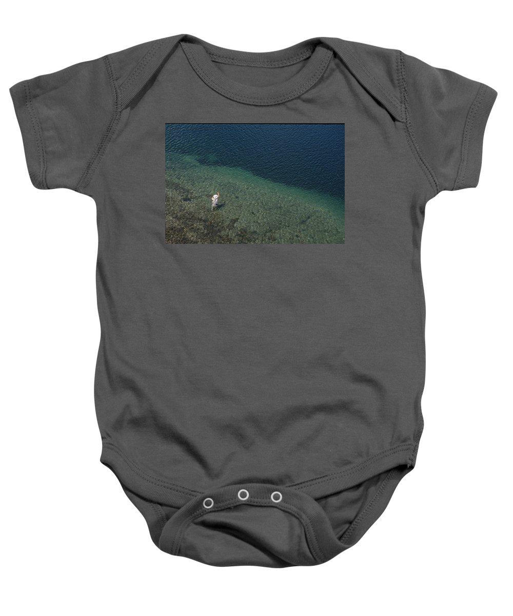Day Baby Onesie featuring the photograph Fly Fishing In Alpine Lake by Topher Donahue