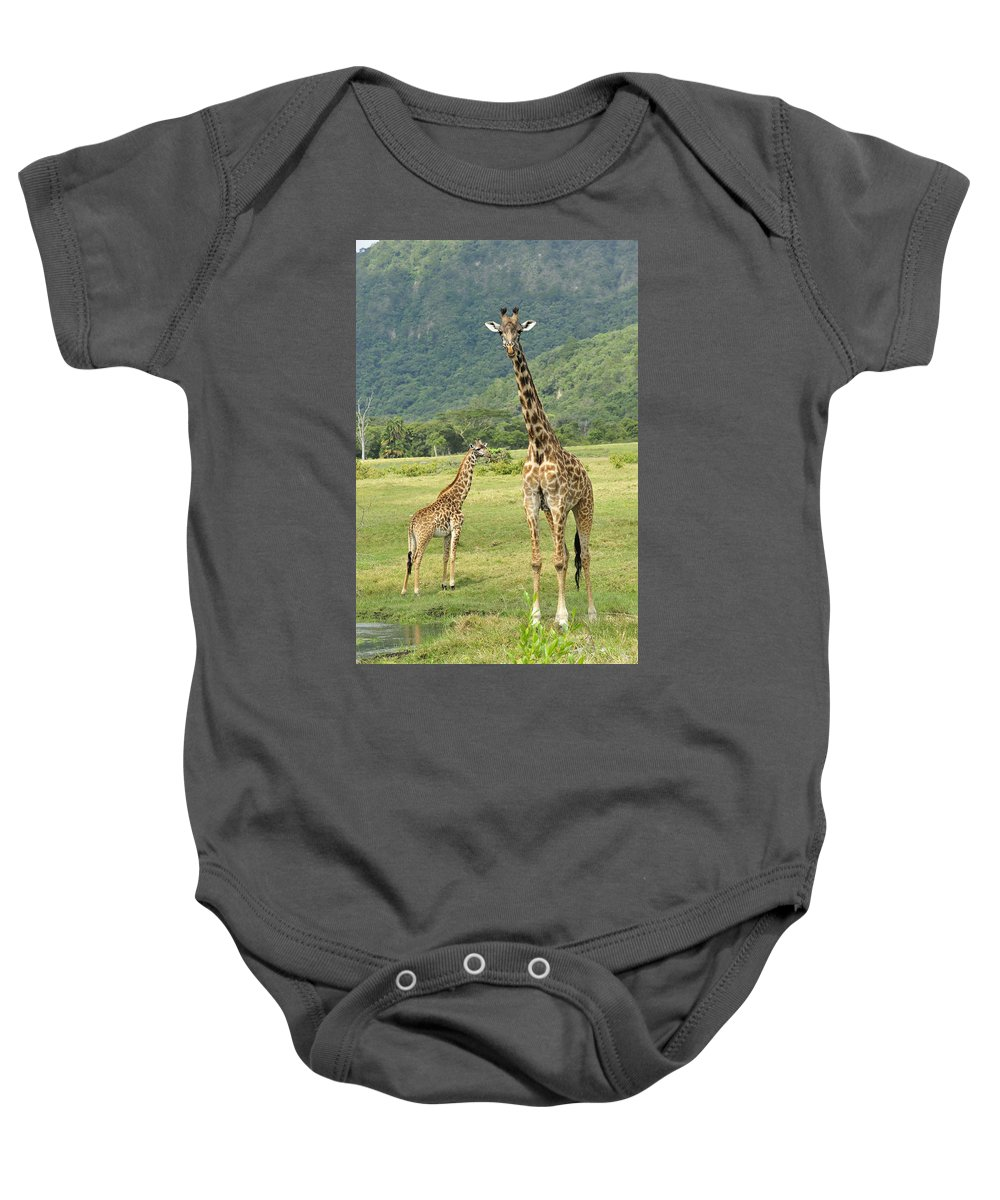 Thomas Marent Baby Onesie featuring the photograph Giraffe Mother And Calftanzania by Thomas Marent