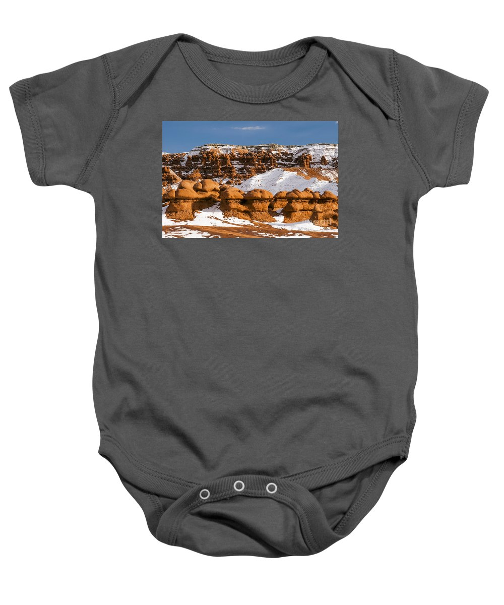 Goblin Valley State Park Utah Hoodoo Hoodoos Fairy Chimneys Toadstools Toadstools Snow Hill Hills Red Rock Parks Landscape Landscapes Snowscape Snowscapes Nature Baby Onesie featuring the photograph Goblin Valley by Bob Phillips