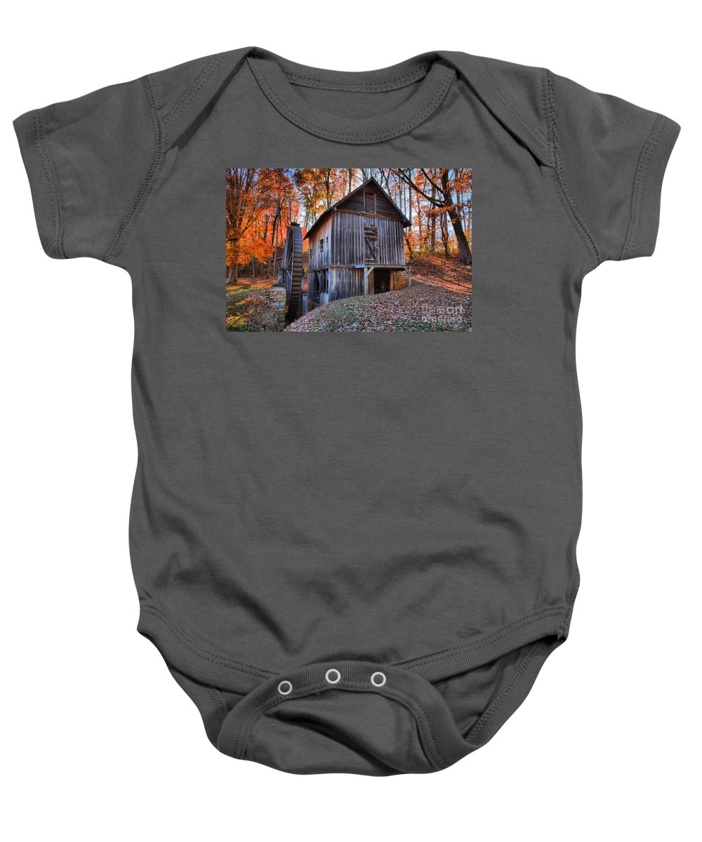 Grist Mill Baby Onesie featuring the photograph Grist Mill Under Fall Foliage by Adam Jewell