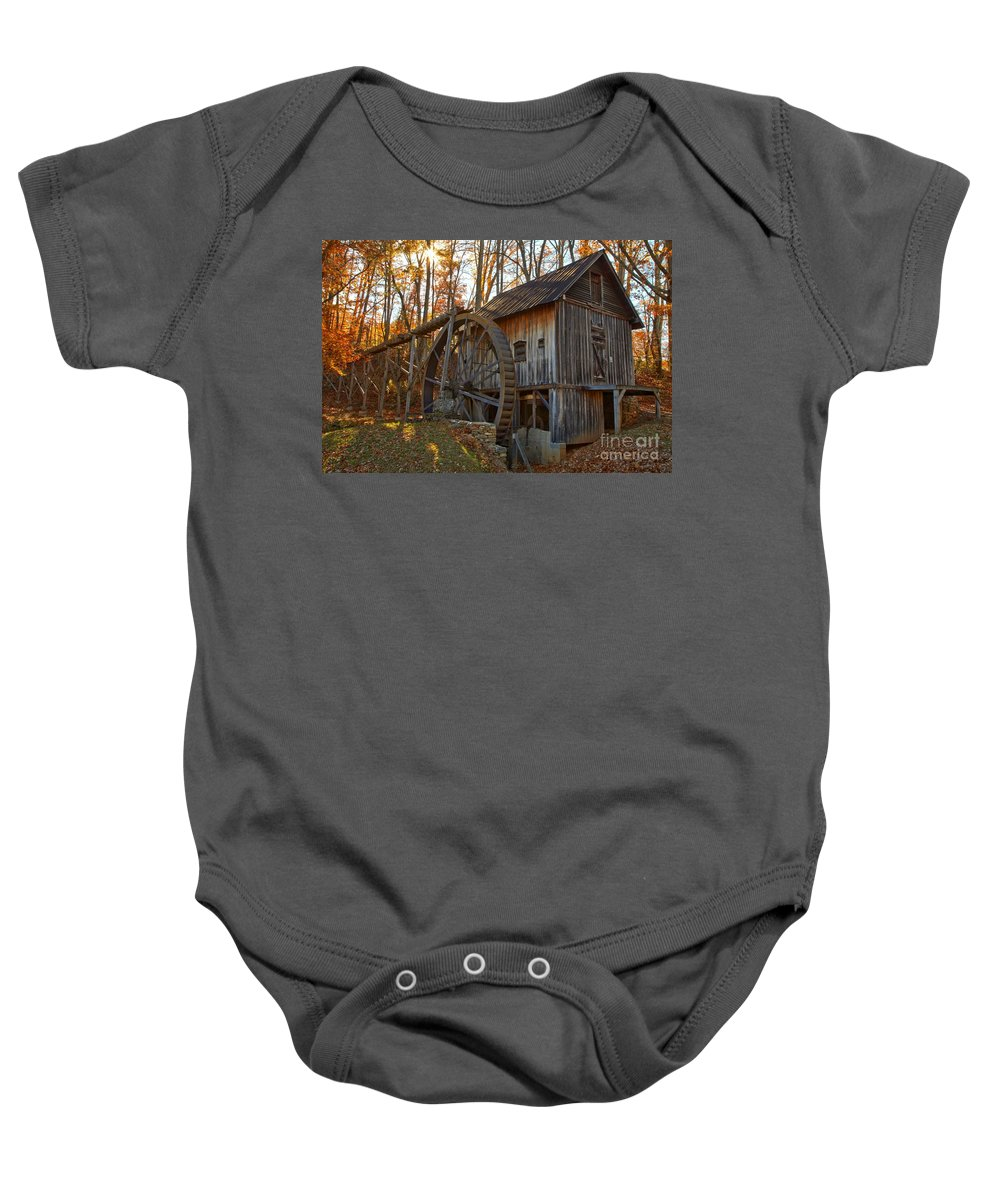 Grist Mill Baby Onesie featuring the photograph Grist Mill With A Golden Glow by Adam Jewell