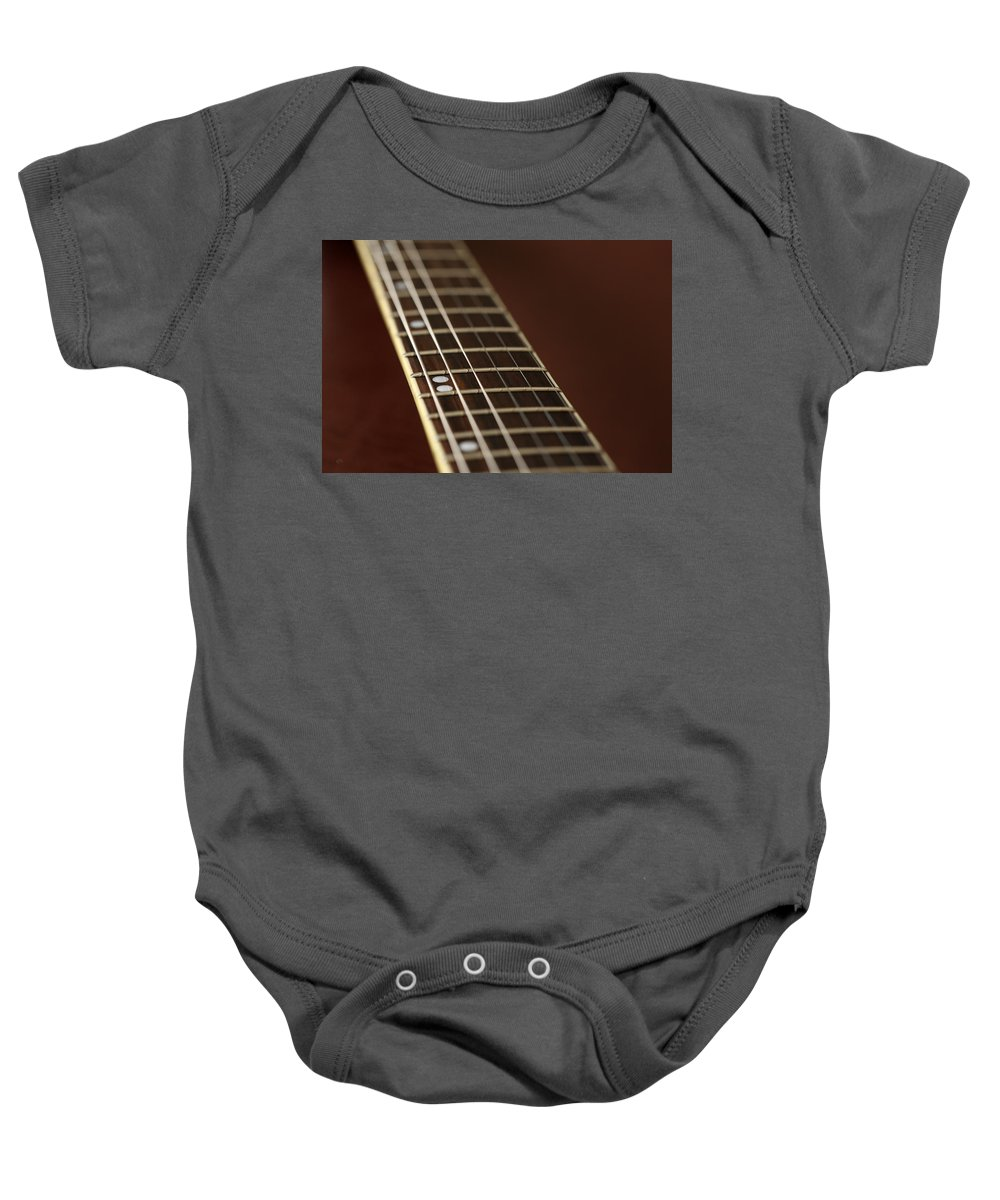 Music Baby Onesie featuring the photograph Guitar Neck by Karol Livote