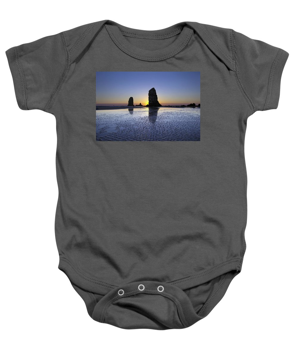 Haystack Baby Onesie featuring the photograph Haystack Needles Rocks At Cannon Beach by Jit Lim