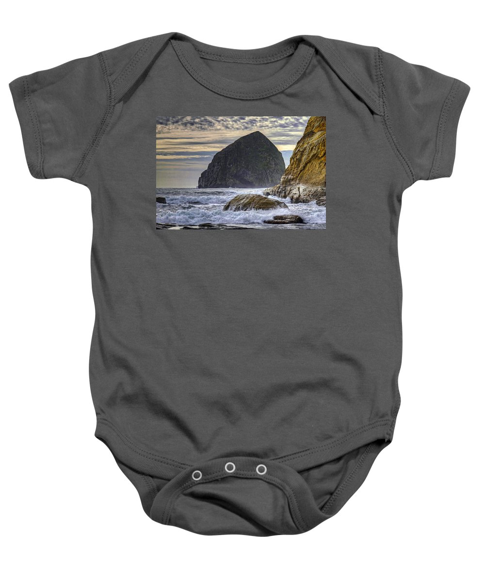 Crashing Waves Baby Onesie featuring the photograph Haystack Rock At Cape Kiwanda by David Gn