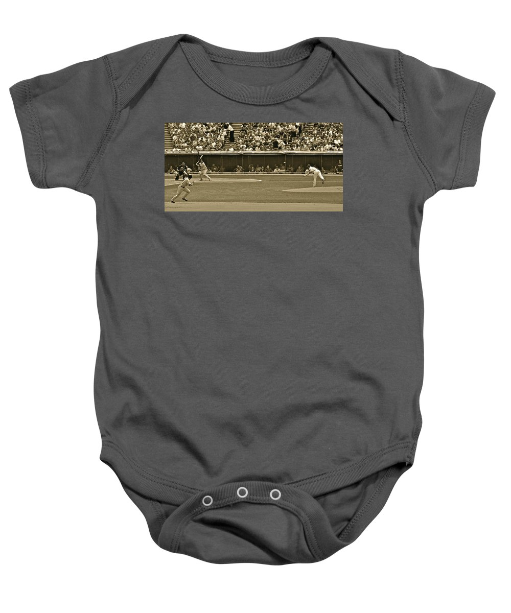 Hit Baby Onesie featuring the photograph Hit And Run by Frozen in Time Fine Art Photography