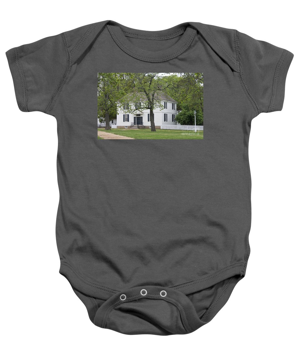 Williamsburg Baby Onesie featuring the photograph House On The Palace Green by Teresa Mucha