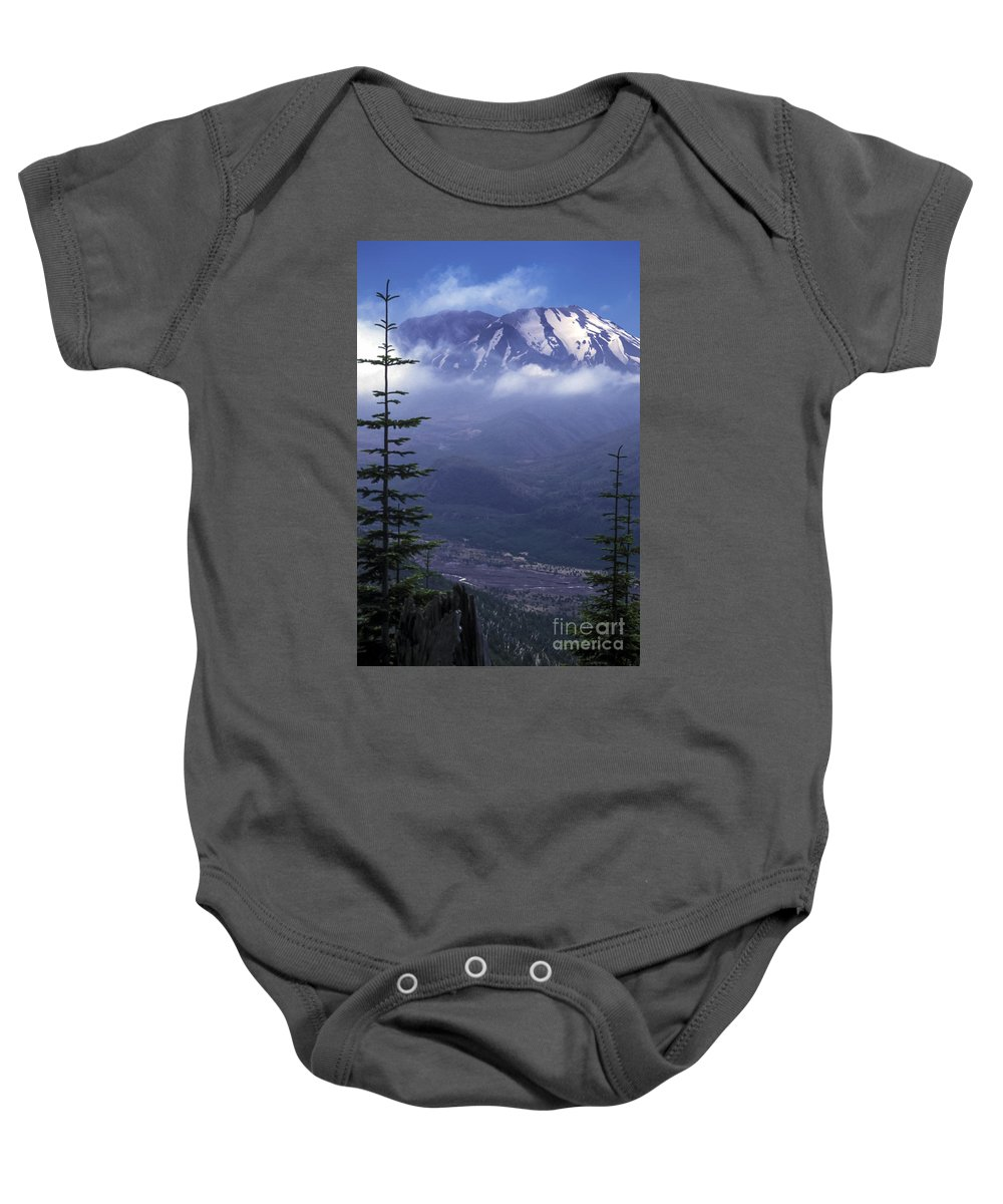 Mount St. Helens National Park Parks Washington Monument Monuments Snow Mountain Peak Mountains Peaks Fir Tree Trees Valley Valleys Clouds Cloud Landscape Landscapes Snowscape Snowscapes Nature Landmark Landmarks Baby Onesie featuring the photograph In The Clouds by Bob Phillips