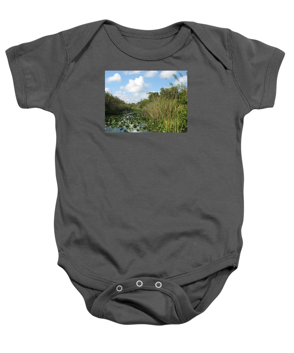 Everglades Baby Onesie featuring the photograph In The Everglades by Christiane Schulze Art And Photography