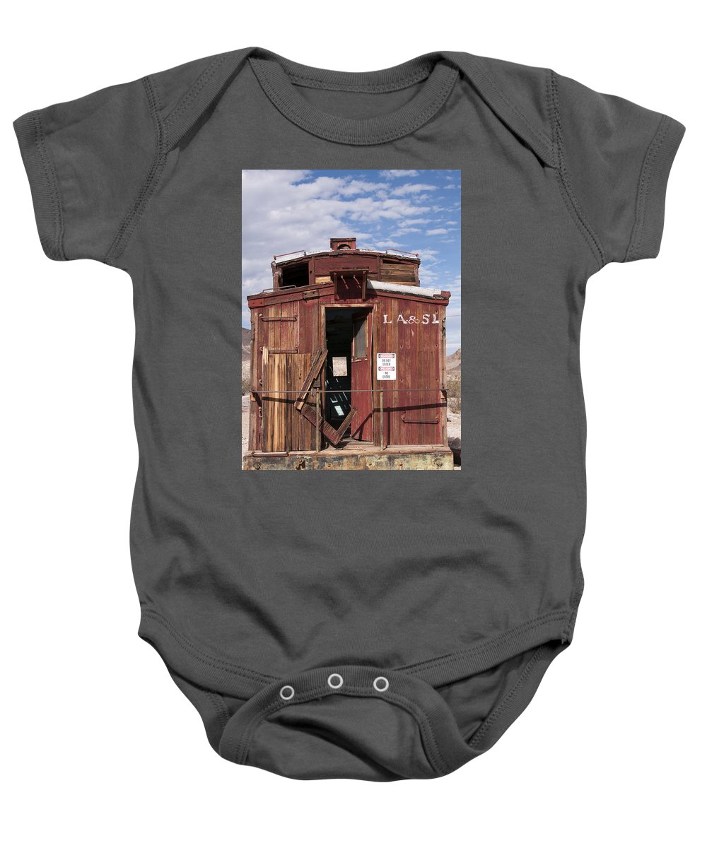 Rhyolite Ghost Town Nevada Train Trains Caboose Cabooses Historic Townsite Ruin Ruins Door Doors Baby Onesie featuring the photograph In Those Days by Bob Phillips