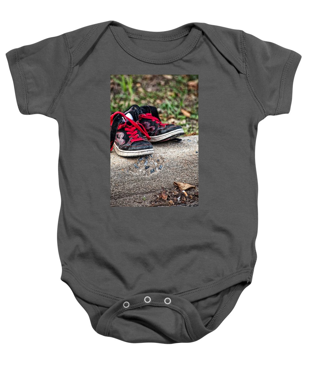Sneakers Baby Onesie featuring the photograph Left On The Curb by Karol Livote