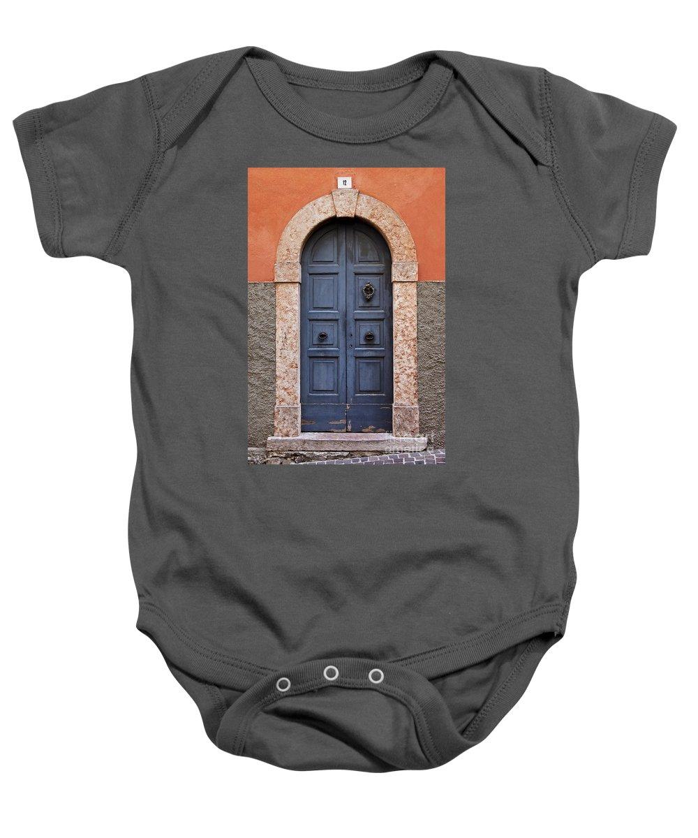 Wood Door Baby Onesie featuring the photograph Limone Door by Brian Jannsen