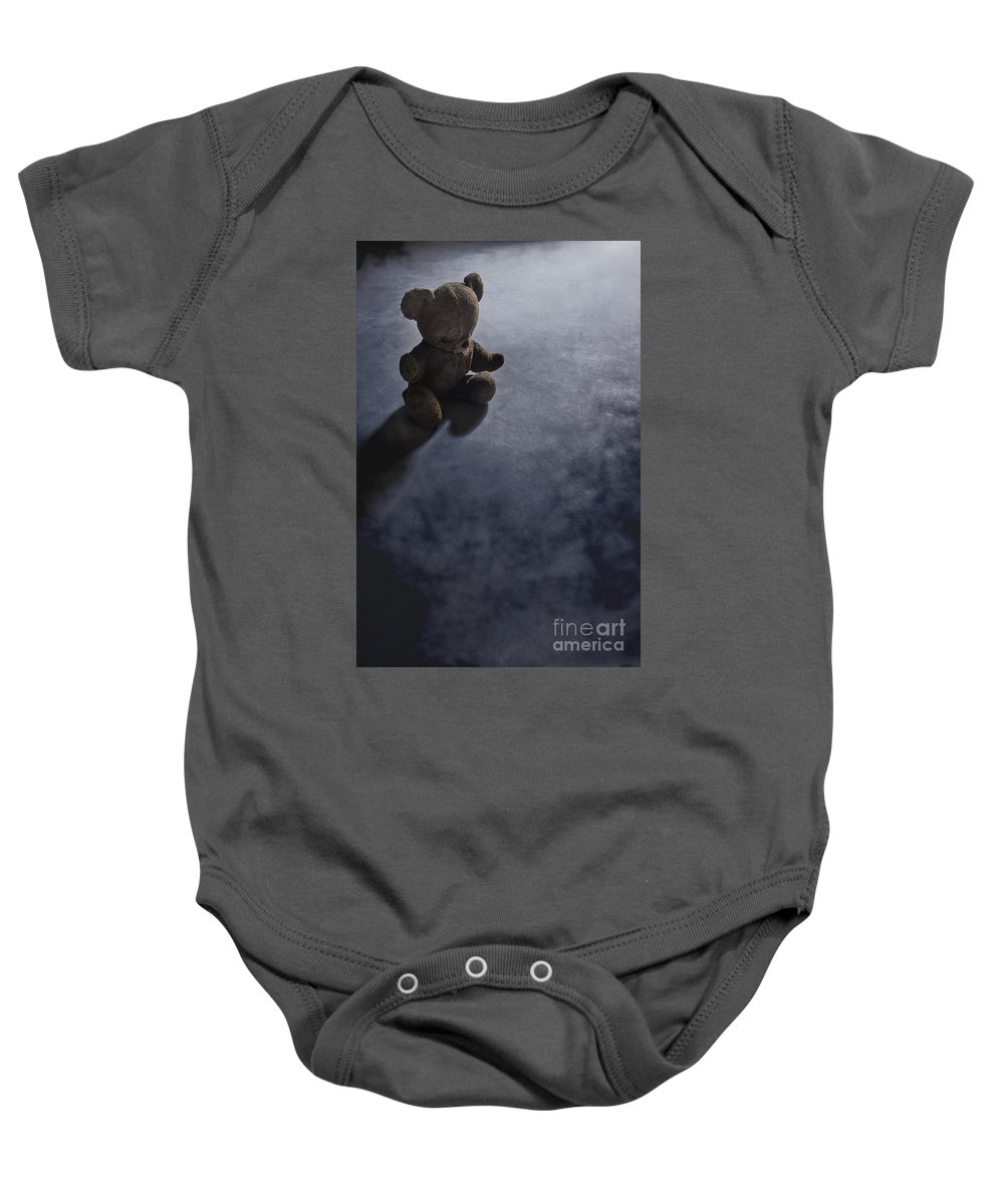Teddy Bear; Bear; Toy; Sitting; Old; Vintage; Brown; Dirty; Plush; Floor; Cement; Alone; Desolate; Lost; Creepy; Mysterious; Depression; Youth; Shadow; Dark; Childhood Baby Onesie featuring the photograph Lost In The Darkness by Margie Hurwich