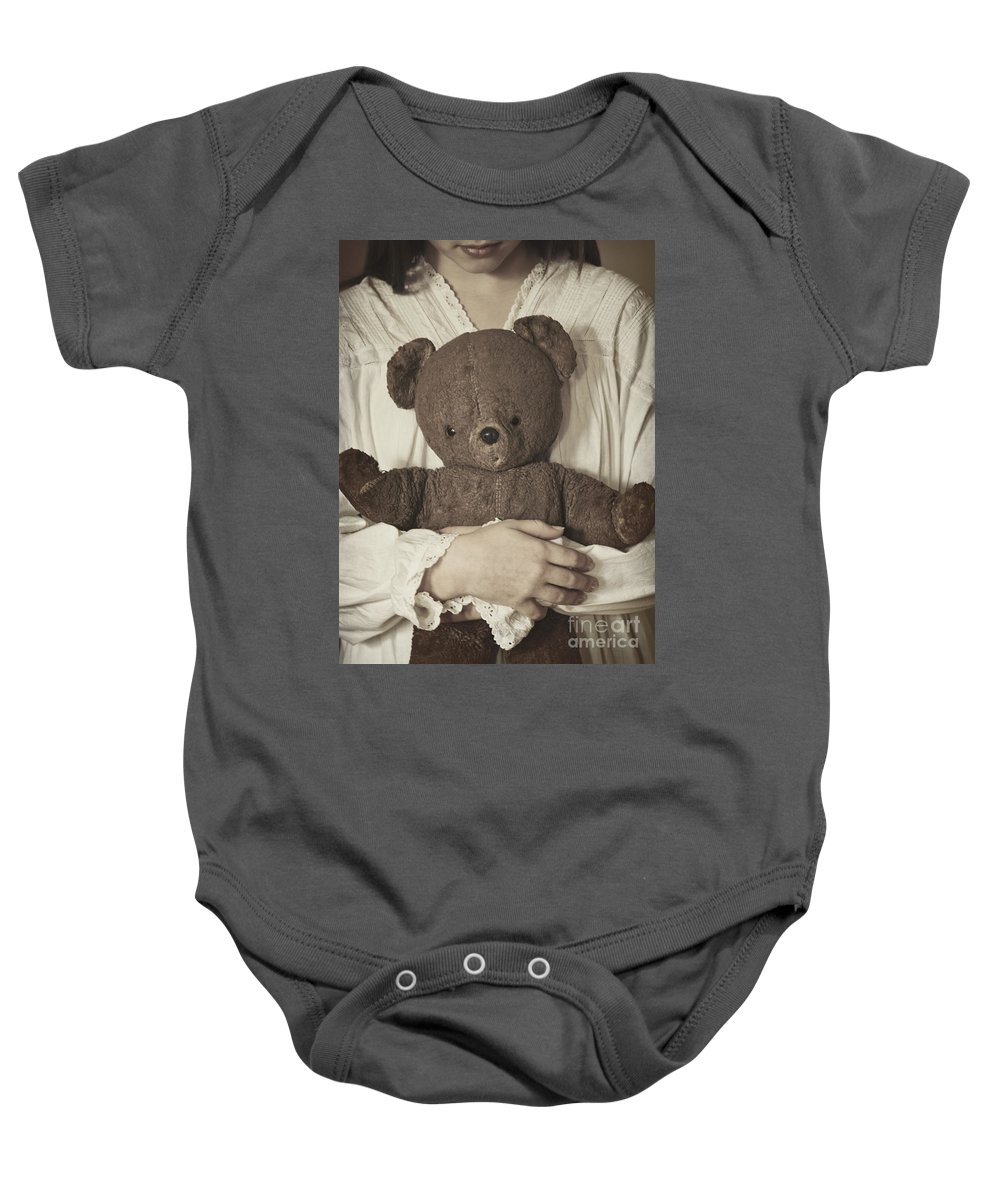 Girl; Female; Teen; Youth; Toddler; Young; Teddy Bear; Bear; Toy; Holding; Night Gown; Close Up; Cuddle; Old; Vintage; Hand; Brown; Dirty; Plush; Looking Down; Face Baby Onesie featuring the photograph Love by Margie Hurwich