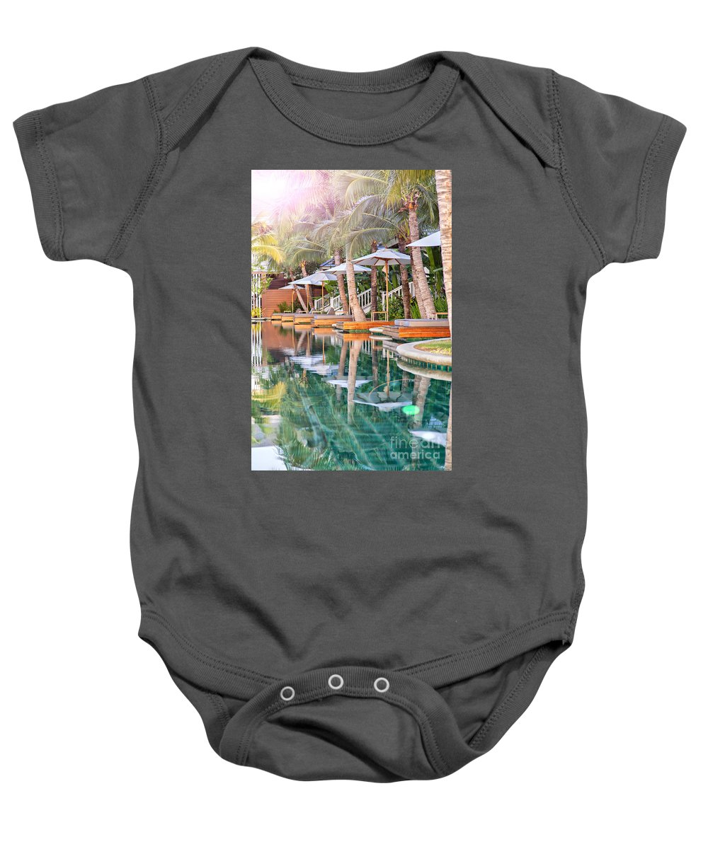 Luxury Baby Onesie featuring the photograph Luxury Pool With Loungers by Sophie McAulay