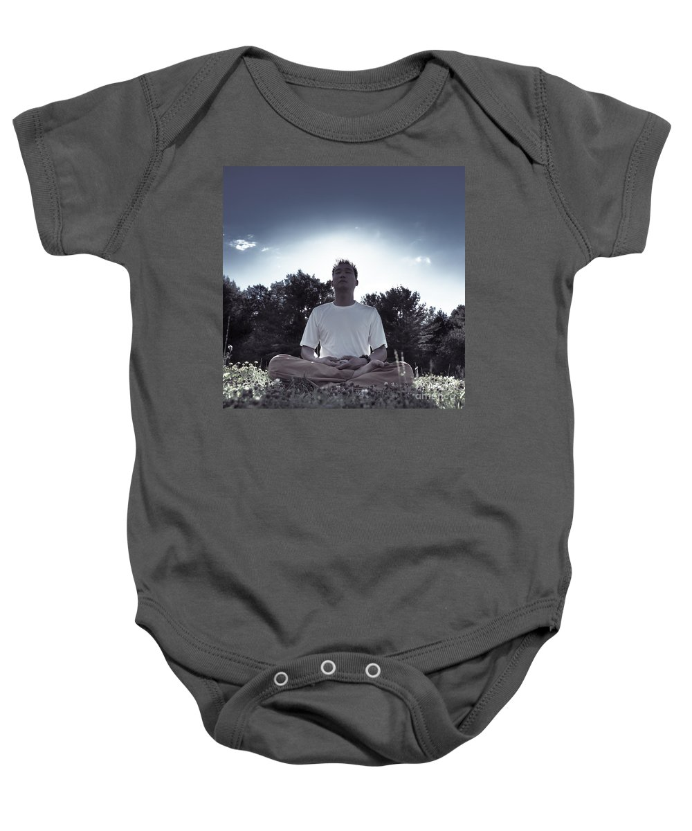 Meditation Baby Onesie featuring the photograph Man Meditating In The Nature During Sunrise by Oleksiy Maksymenko