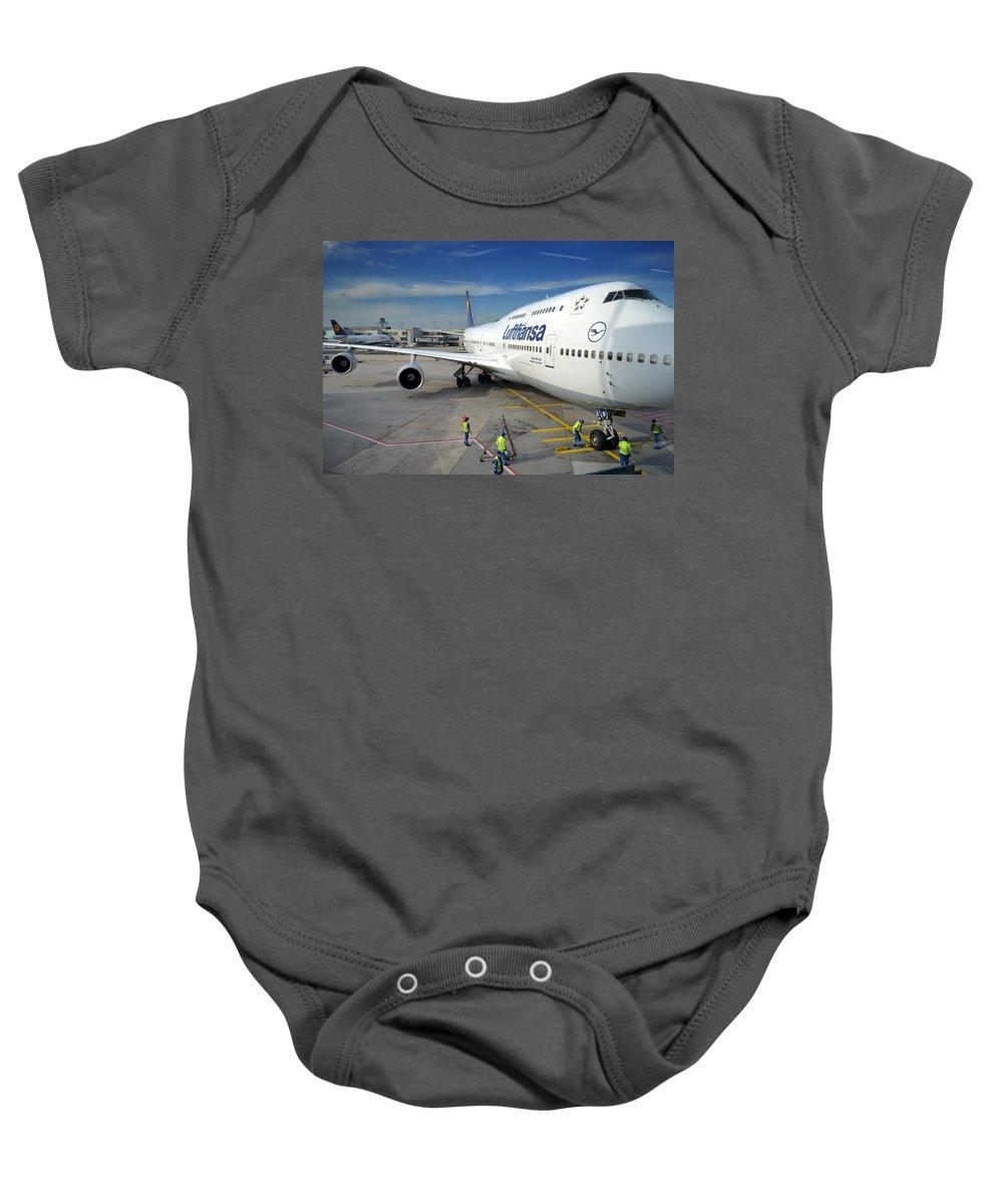 Airplane Baby Onesie featuring the photograph Men At Work by Jatinkumar Thakkar