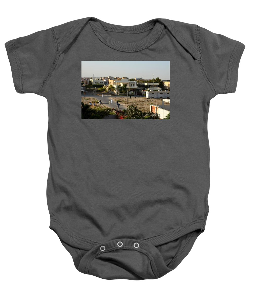 Cricket Baby Onesie Featuring The Photograph Men Play Street Cricket Karachi Pakistan By Imran Ahmed
