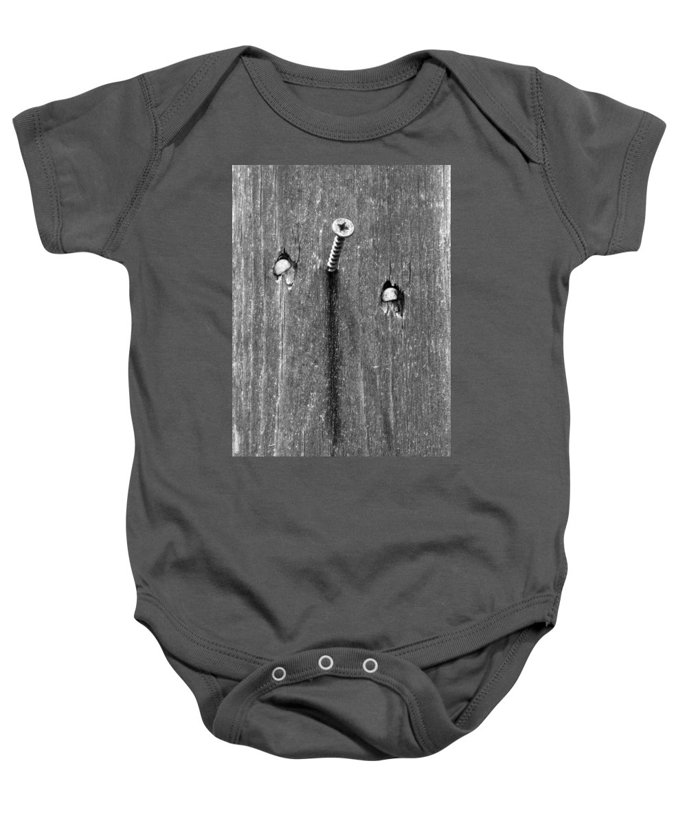 Nail Baby Onesie featuring the photograph Nailed It - Bw by Pamela Critchlow