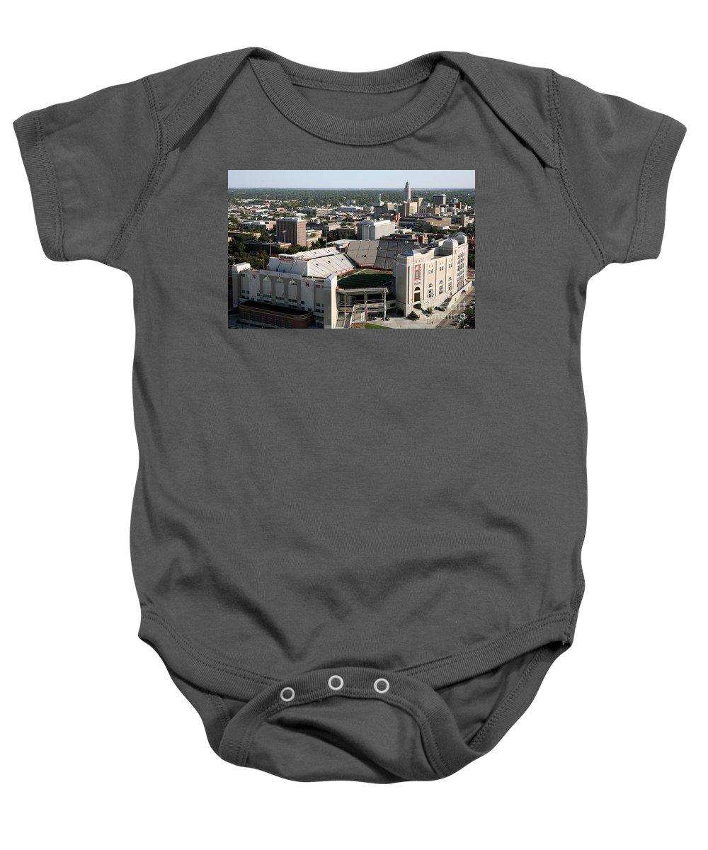 Aerial Baby Onesie featuring the photograph Nebraska Cornhuskers Stadium Lincoln by Bill Cobb