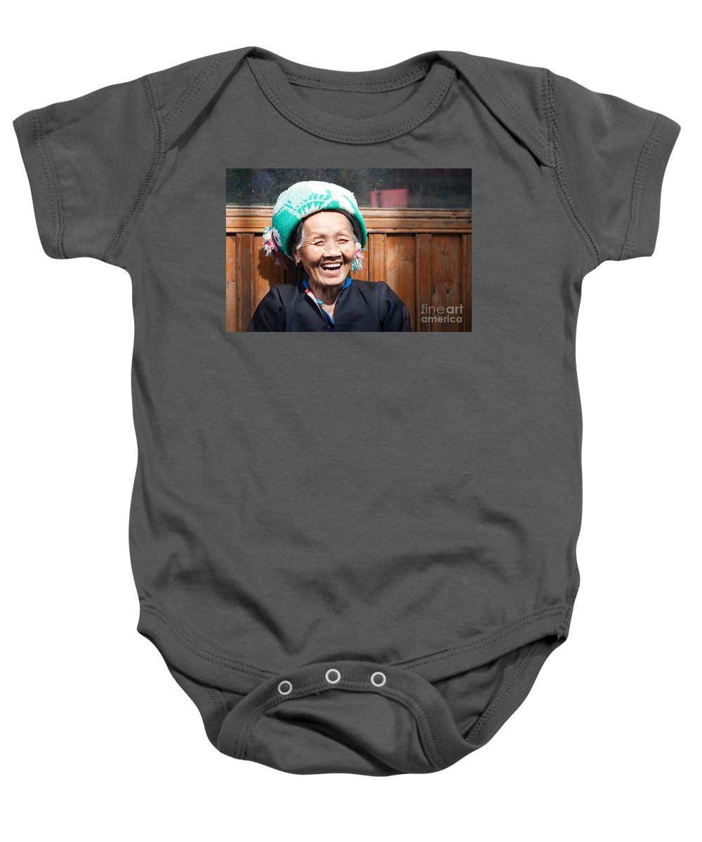 China Baby Onesie featuring the photograph Old Chinese Zhuang Minority Lady Smiling China by Matteo Colombo