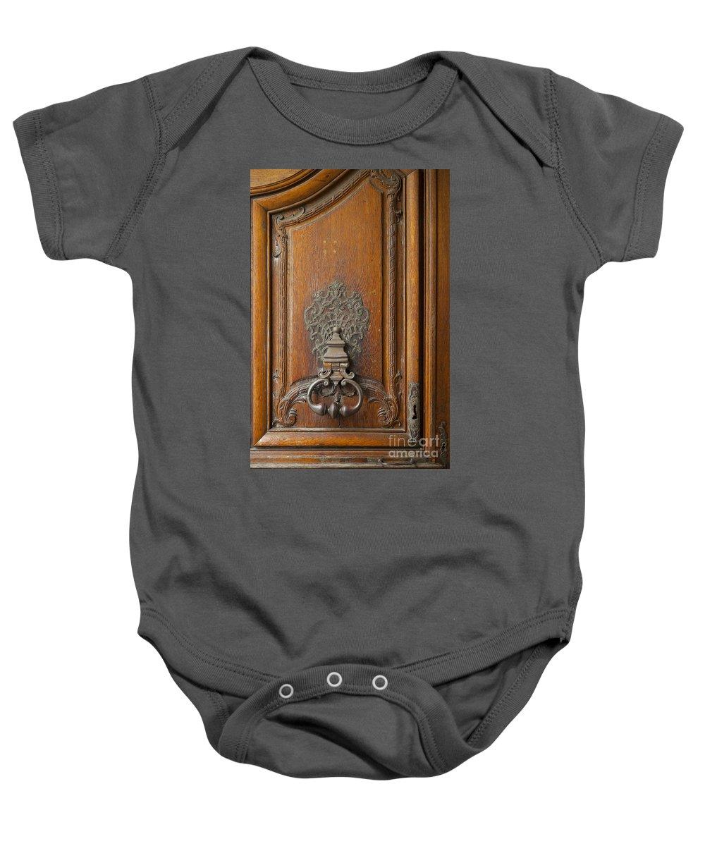 Carnavalet Baby Onesie featuring the photograph Old Door Knocker by Brian Jannsen
