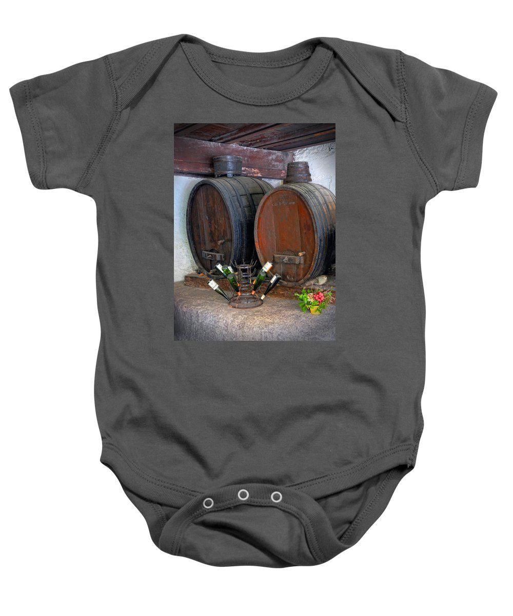 Wine Baby Onesie featuring the photograph Old French Wine Casks by Dave Mills