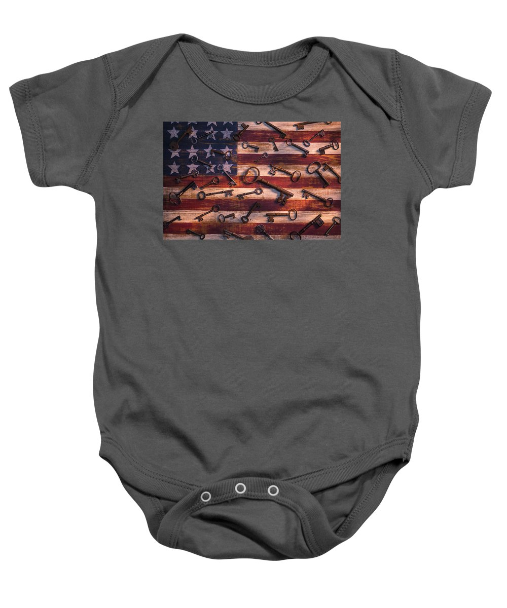 Old Baby Onesie featuring the photograph Old Keys On American Flag by Garry Gay