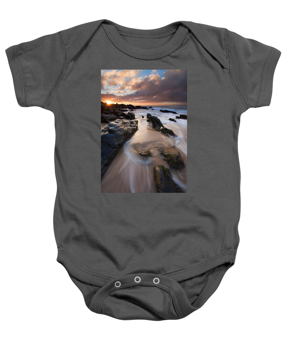 Basham Beach Baby Onesie featuring the photograph On The Rocks by Mike Dawson