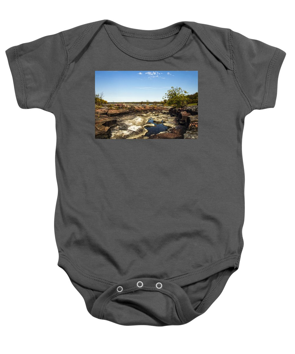 Pinawa Baby Onesie featuring the photograph On The Rocks by Sandra Parlow