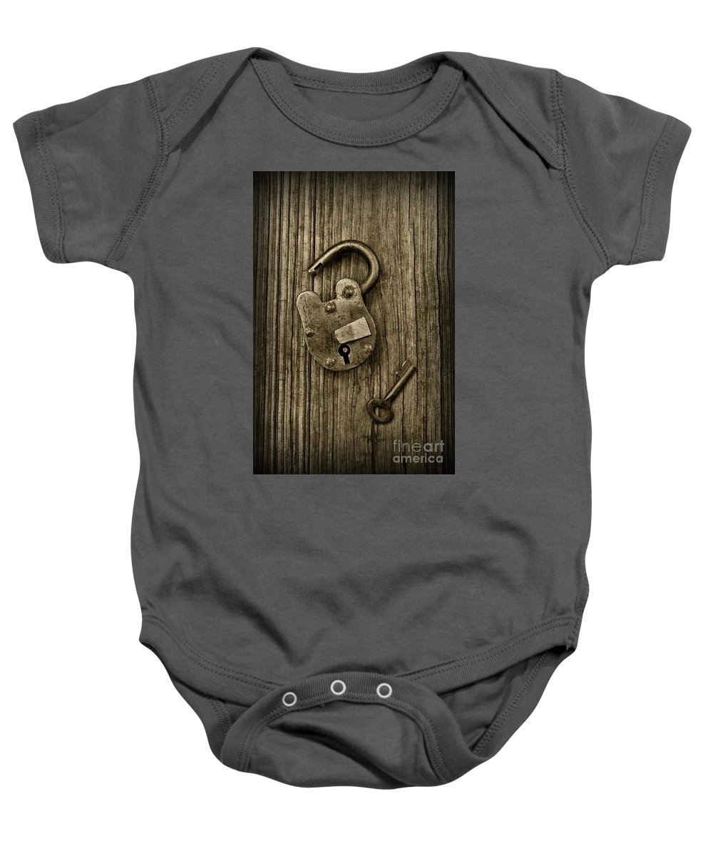 Paul Ward Baby Onesie featuring the photograph Padlock Black And White by Paul Ward
