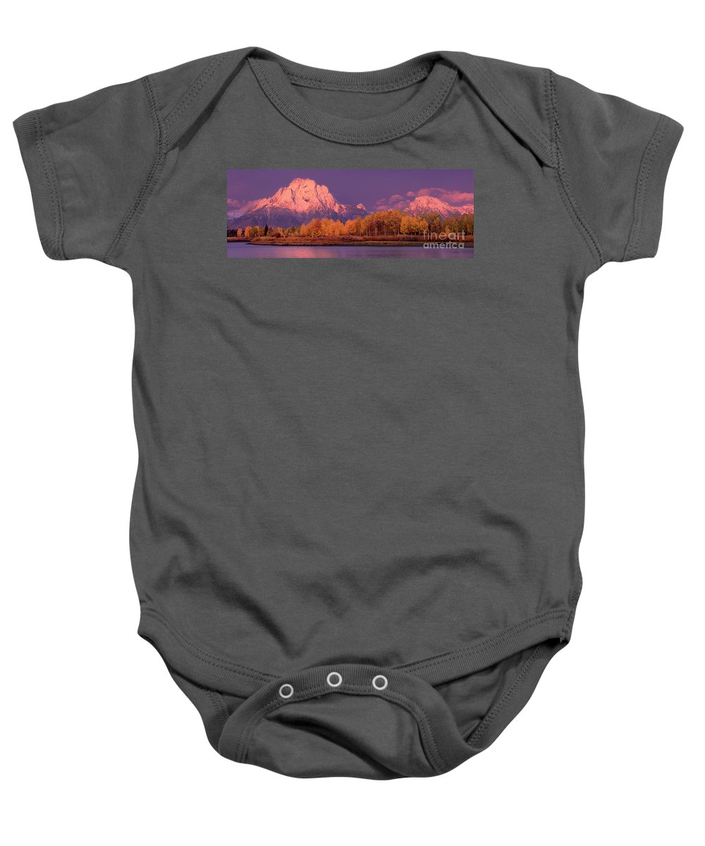America Baby Onesie featuring the photograph Panorama Dawn Lights Up Mount Moran In Grand Tetons National Park by Dave Welling