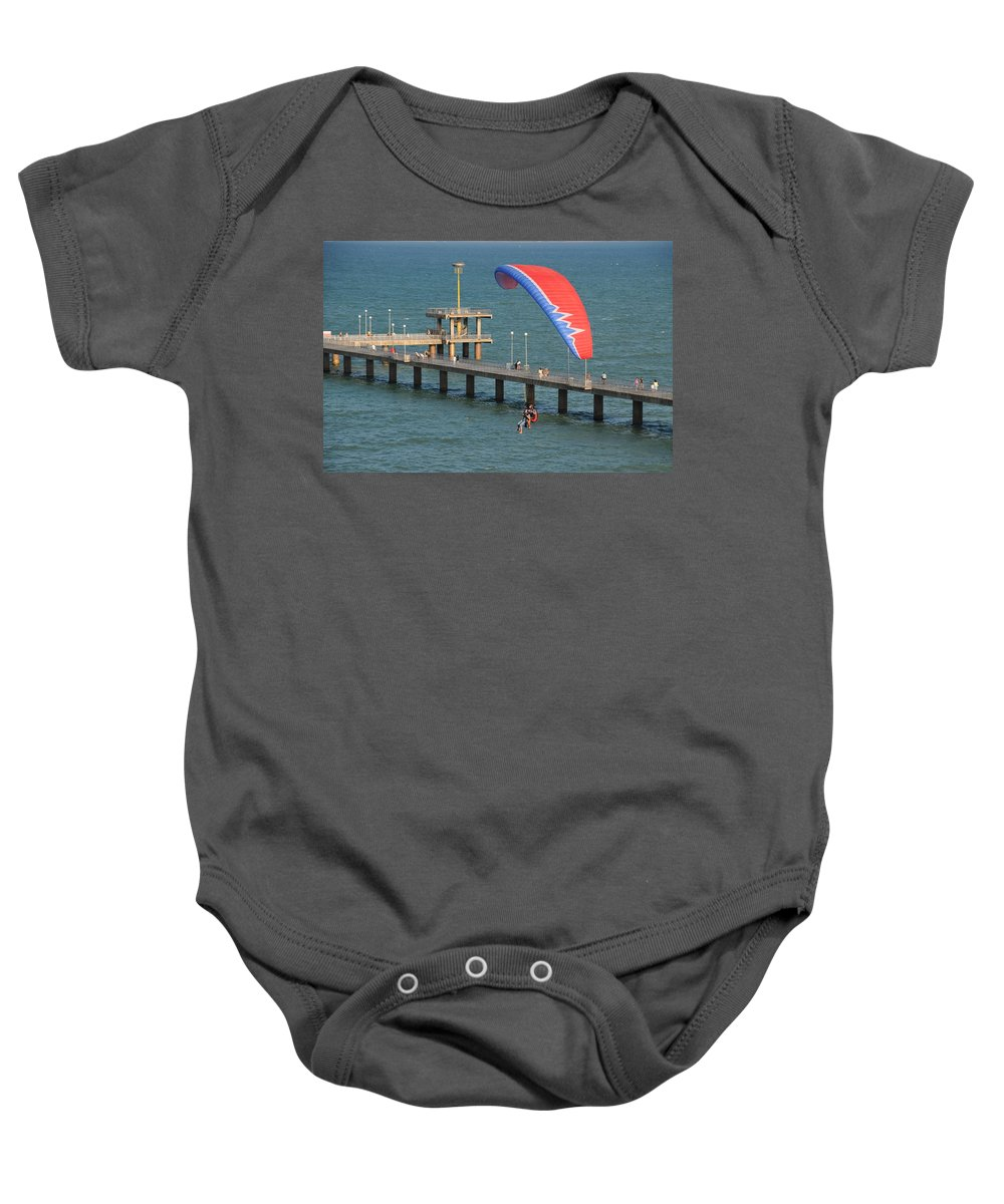 Paraglider Baby Onesie featuring the photograph Paraglider Near Bourgas by Tatyana Baykusheva