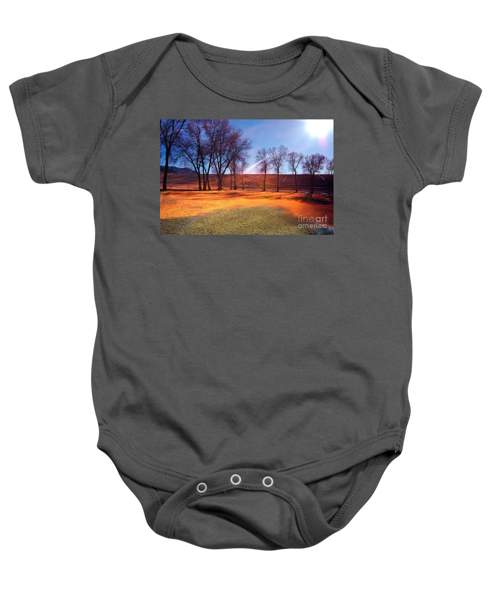 Background Baby Onesie featuring the photograph Park In Mcgill Near Ely Nv In The Evening Hours by Gunter Nezhoda