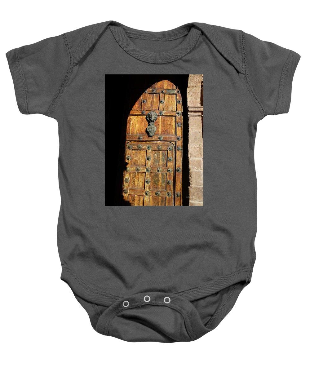 Door Baby Onesie featuring the photograph Peruvian Door Decor 17 by Xueling Zou