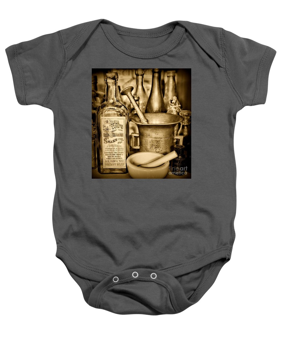 Paul Ward Baby Onesie featuring the photograph Pharmacy - Snake Oil - Black And White by Paul Ward