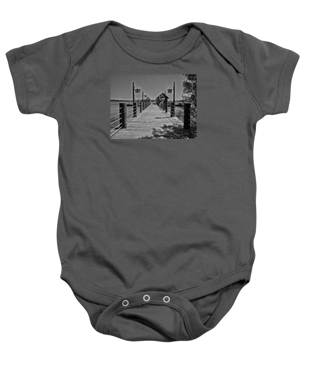 Black And White Baby Onesie featuring the photograph Pier At Fort Wilderness In Black And White Walt Disney World by Thomas Woolworth