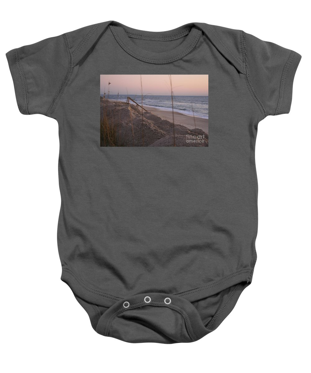 Pink Baby Onesie featuring the photograph Pink Sunrise On The Beach by Nadine Rippelmeyer