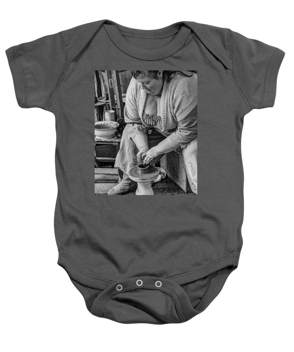 Pottery Baby Onesie featuring the photograph Potters Wheel V1 by John Straton