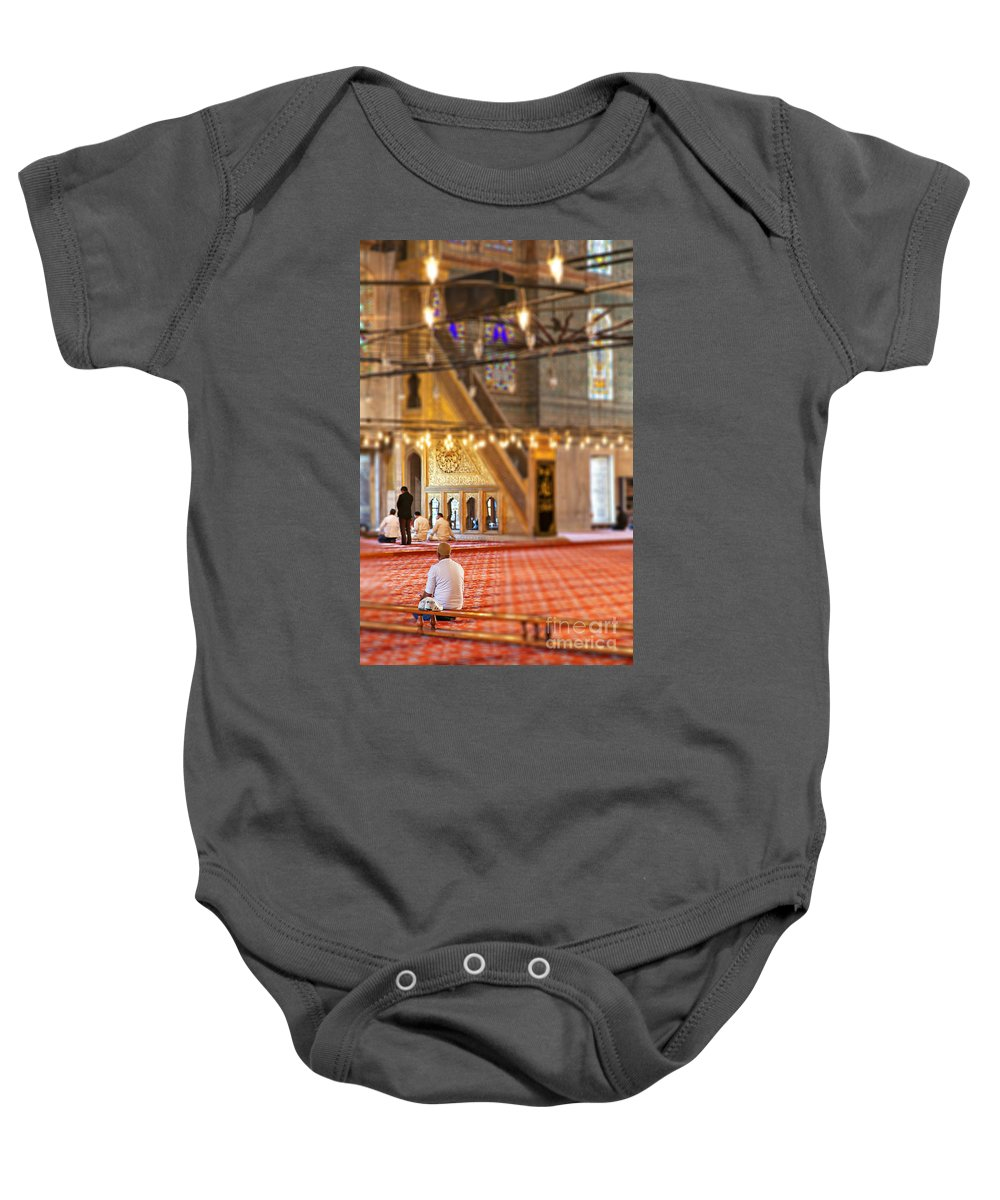 Allah Baby Onesie featuring the photograph Praying Muslims by Sophie McAulay