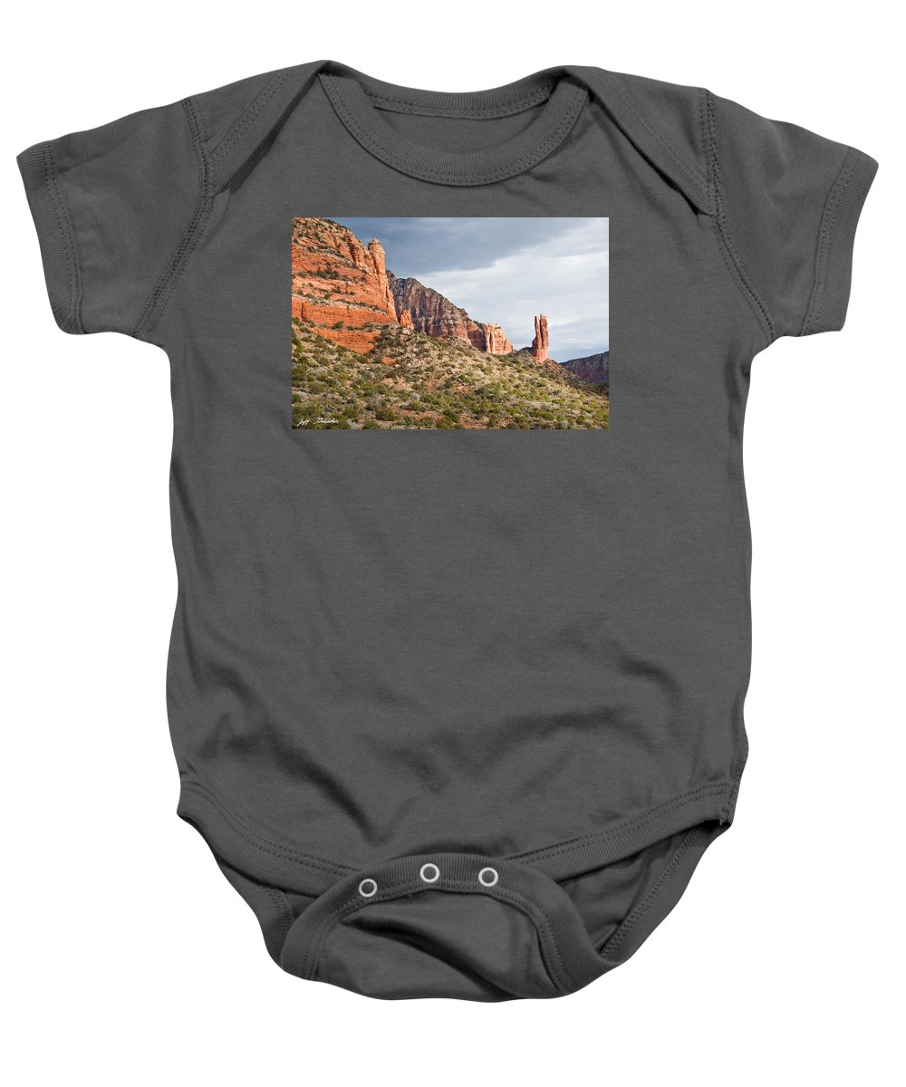 Arizona Baby Onesie featuring the photograph Rabbit Ears Spire At Sunset by Jeff Goulden