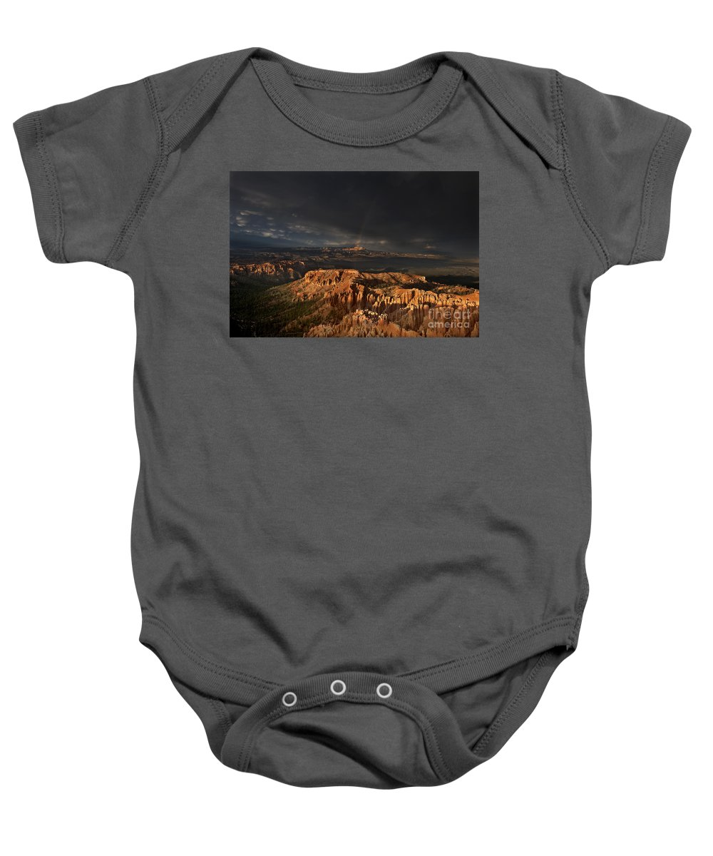 North America Baby Onesie featuring the photograph Rainbow And Thunderstorm Over The Paunsaugunt Plateau by Dave Welling