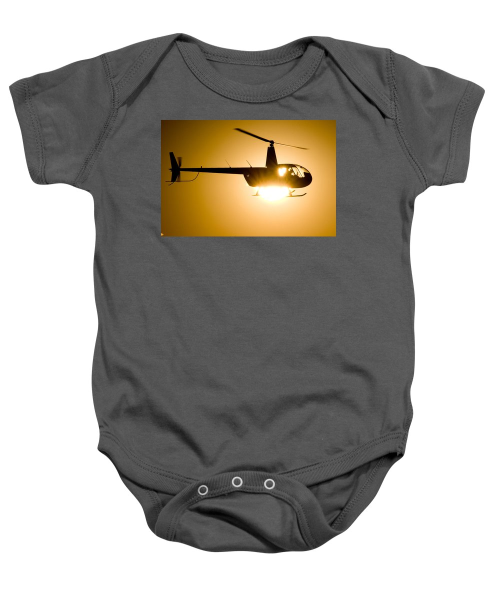 Robinson R44 Raven Ii Baby Onesie featuring the photograph Raven Sun by Paul Job