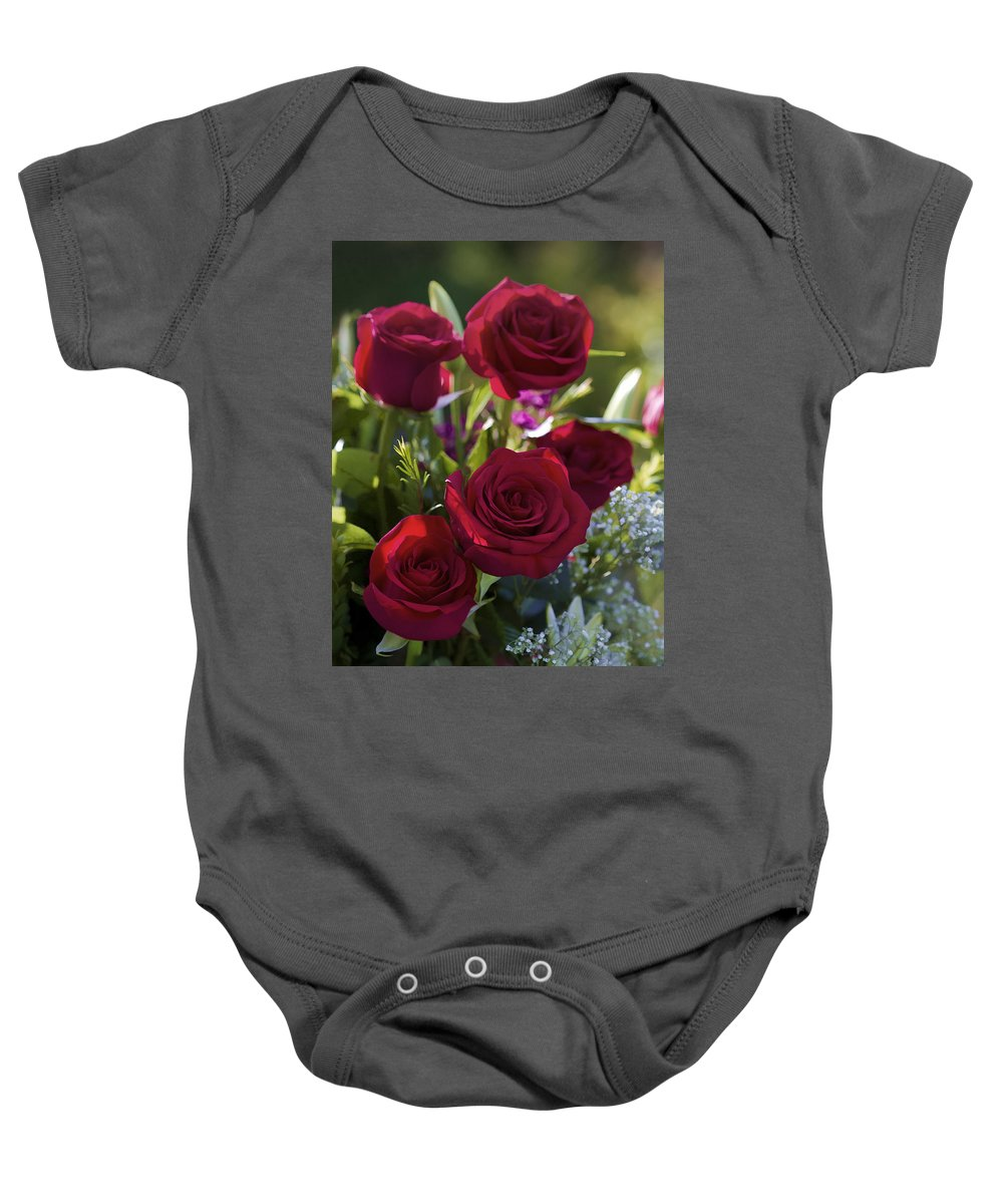 Red Baby Onesie featuring the photograph Red Roses The Language Of Love by Kathy Clark