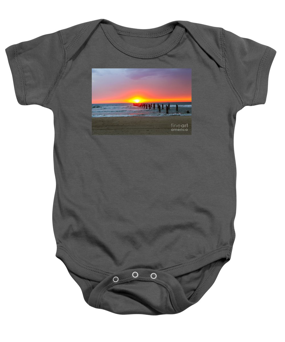 Tranquil Scene Baby Onesie featuring the photograph Remains Of A Wharf At Sunset by Gal Eitan