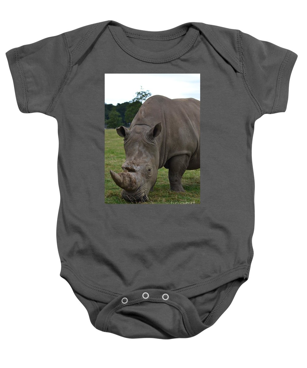Animal Baby Onesie featuring the photograph Rhino 2 by Stephanie Guinn