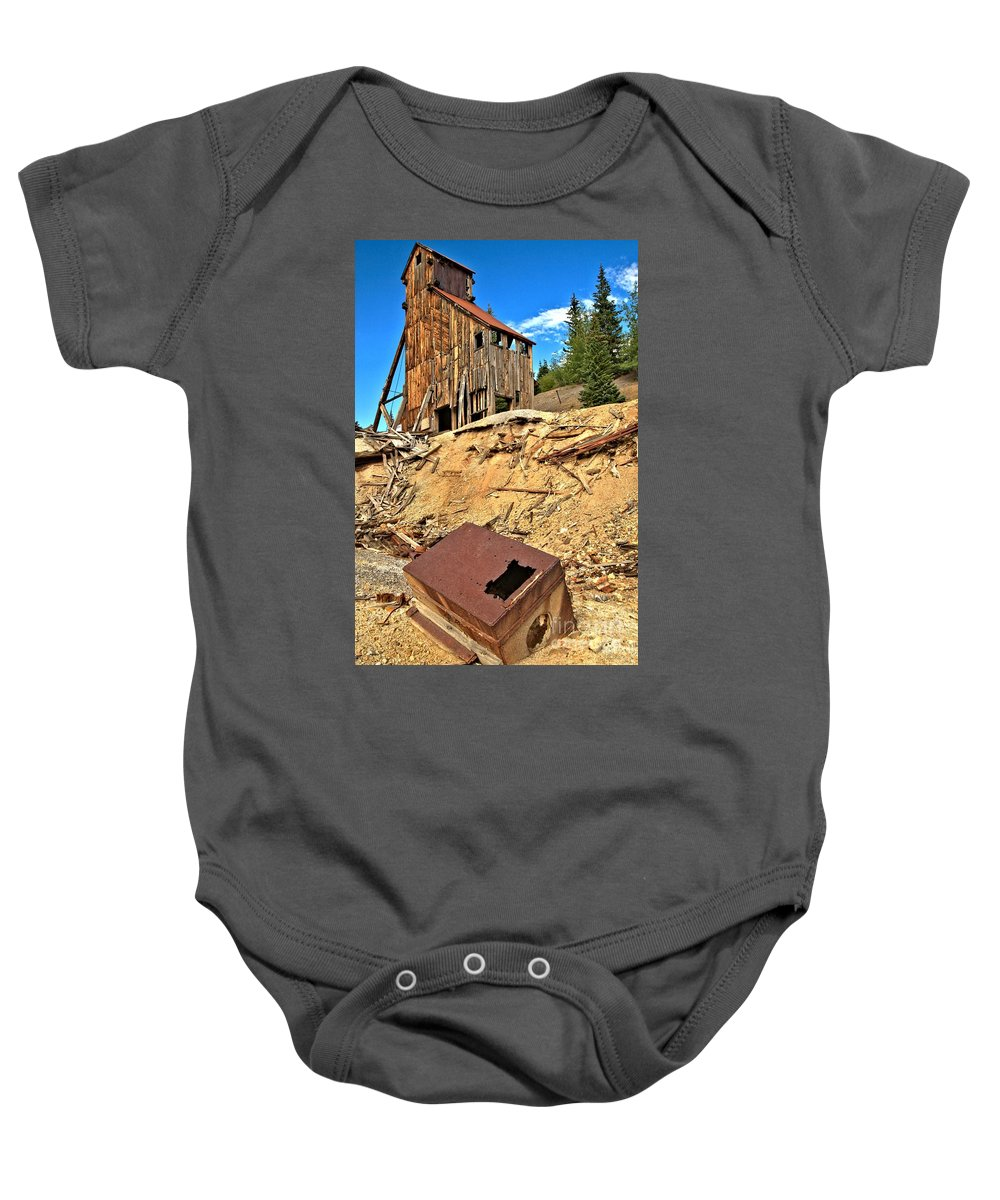 Yankee Girl Mine Baby Onesie featuring the photograph Rubble Under Yankee Girl by Adam Jewell