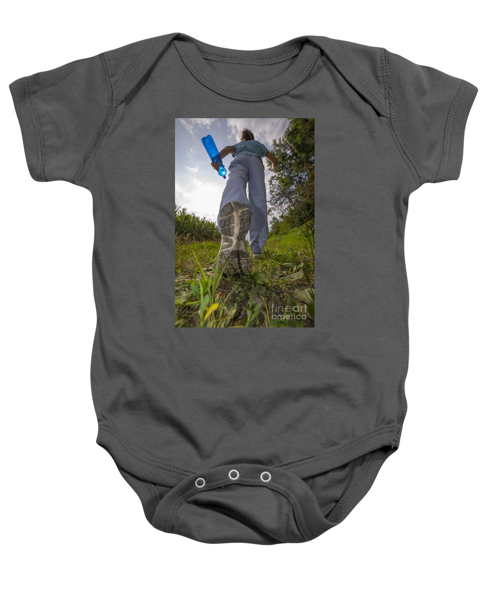Woman Baby Onesie featuring the photograph Running by Mats Silvan