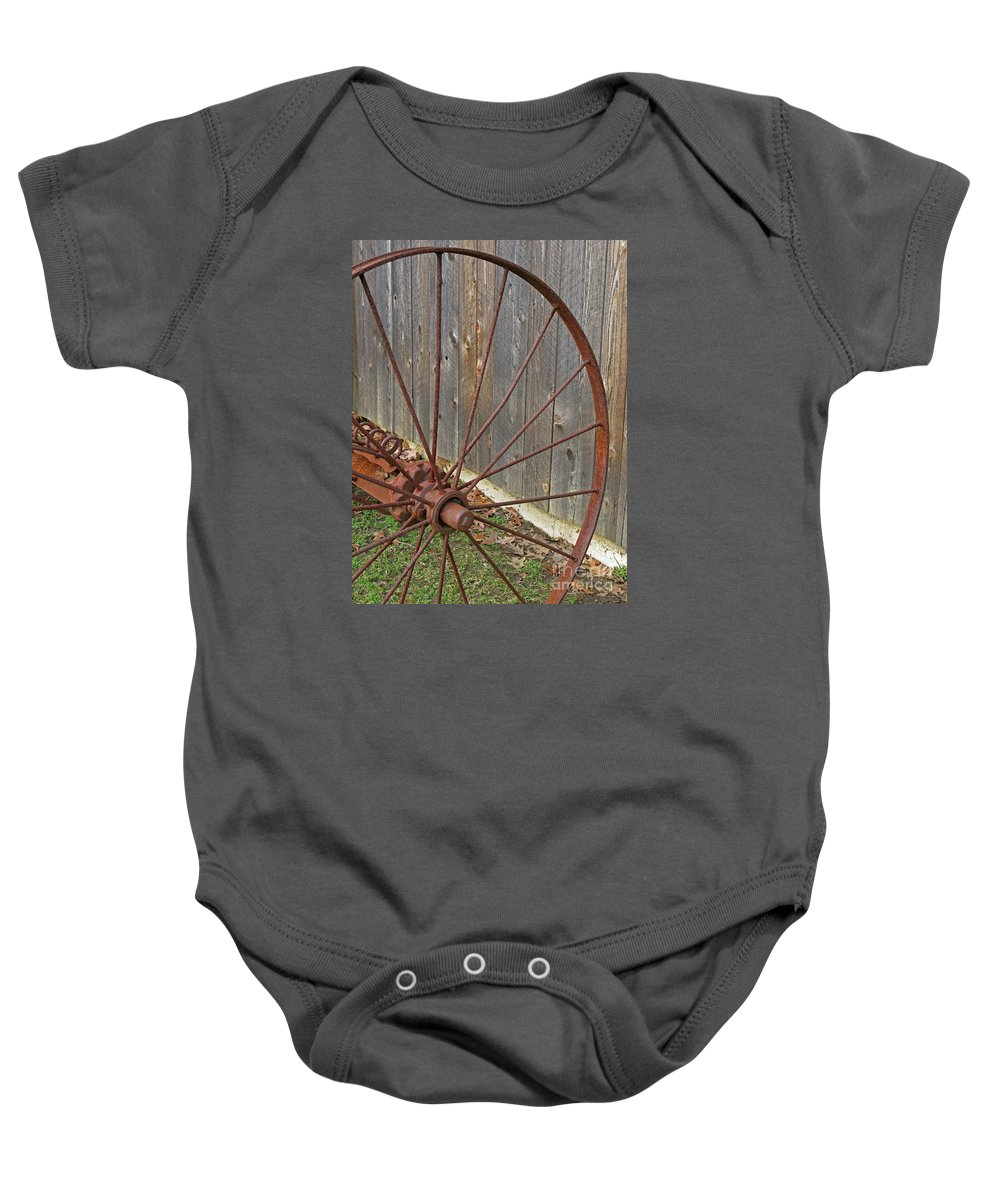 Relic Baby Onesie featuring the photograph Rural Relics by Ann Horn
